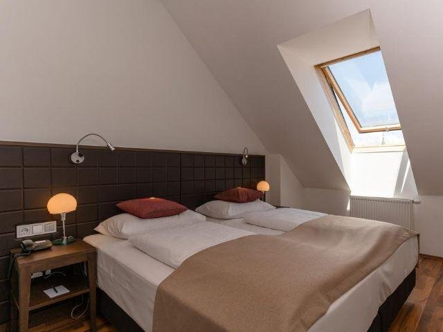 Klagenfurt am Wörthersee - Hotel Sandwirth - voorbeeld kamer